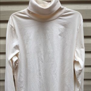 Woman Within Turtleneck in Cream